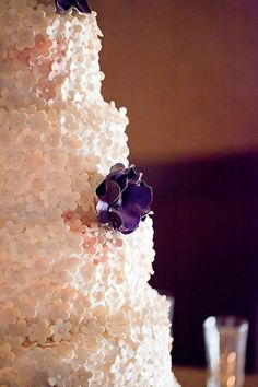 Mini sugar flowers cover every inch of this delicious cake. Photo Credit: Angel Canary Photography (=)