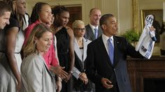 Obama salutes WNBA's Minnesota Lynx at White House    Published September 18, 2012    Associated Press        Obama Lynx Basketball2.jpg        Sept. 18, 2012: President Barack Obama, center right, holds up a Lynx team basketball jersey presented to him by Seimone Augustus, center left, as he honors the WNBA Champion Minnesota Lynx, in a ceremony in the East Room of the White House in Washington. (AP2012)      Obama Lynx Basketball.jpg