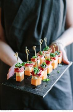 Wedding cocktail hour food idea - melon, blue cheese, prosciutto & basil canapés {Courtesy of The Pretty Blog}