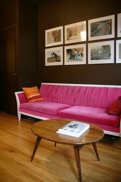 Plush Pink Mid-Century Modern Sofa. modhomeec.com  I like the having prints above the couch