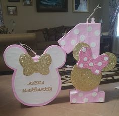 These were the Piñatas I had made for my daughters first birthday, and they came out amazing! The Minnie Mouse silhouette was modeled after the Invitations I made. It was a Pink & Gold Minnie Mouse party.