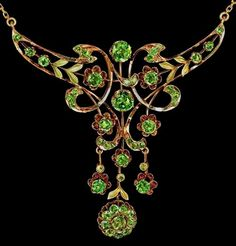 "Belle Epoque Antique Russian Demantoid Garnet Necklace made in Moscow between 1908 and 1917. Rose gold necklace is accented with matte green gold chased leaves, embellished with 48 sparkling Russian demantoid garnets. The demantoids display typical ""horse tail"" inclusions confirming their Ural Mountain origin.The biggest two demantoids have a combined weight of approximately 1.8 ct, and the total approximate weight of all demantoids is around 5.7 carats. w/maker's marks, etc."