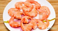 How to Cook Frozen Shrimp. A bag of frozen shrimp can be a lifesaver come dinnertime. If not properly prepared, however, your favorite seafood dishes can easily turn into a bland, watery mess. The key to cooking with frozen shrimp is to. Pan Fried Shrimp, Breaded Shrimp, Ways To Cook Shrimp, How To Devein Shrimp, Lettuce Cups, Le Diner, Seafood Dishes, Recipe Using, Mayonnaise