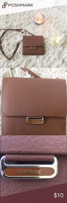 """Vintage brown leather carrying wallet Perfect for someone who can carry light. It comes with an optional strap to carry like a bag or remove to place in a purse. This wallet is in great condition with no signs of wear.  Open to offers on this item.  Width: 6"""" Length: 5 1/2 """" Strap length: 25"""" Vintage Bags Wallets"""