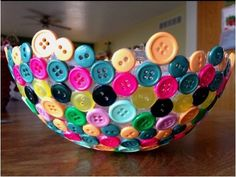 How fun! Blow up a balloon~ glue buttons to it~let dry and pop it! Look in the $1.00 bins or in the sewing supplies at Michaels for buttons. How about making this with red, green and white buttons for Xmas? Red and Pink for Valentines Day?