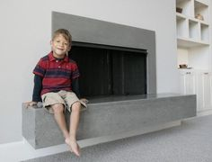 kansas city starWendy Lucas, of Overland Park, Kan., has a concrete fireplace designed by Sara Noble that appears to float. Here, Lucas' son, Ivan, 5, sits on the hearth.