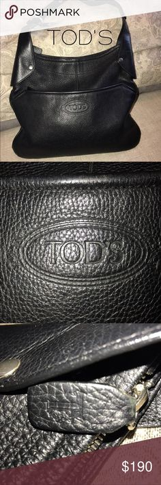Tod's Large Black Leather Hobo Bag In good condition.  Front and back leather of bag is flawless.  Piping in Bottom corners have some wearing, a little repair work has minimized so very un-noticeable.        Please note photo of Genuine Leather with date code stamp.  Very nice bag. Tod's Bags Hobos