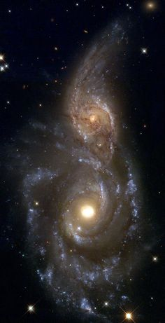 HST image of interacting spiral galaxies NGC 2207 and IC 2163 -  Located about 130 million light years from Earth, in the constellation of Canis Major, this pair of spiral galaxies has been caught in a grazing encounter. - Credits: Debra Meloy Elmegreen (Vassar College) et al., & the Hubble Heritage Team (AURA/ STScI/ NASA)