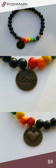 LGBT Pride Bracelet - Handmade with black glass beads and colorful wooden beads with a love charm. Strung onto strong, stretchy jewelry string. - New. Handmade.  - Can be adjusted to fit smaller or larger wrists - just let me know ? Jewelry Bracelets
