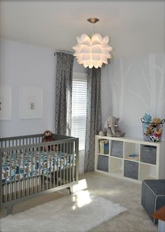 Name: Grayson Location: Chapel Hill, NC We are expecting our first child around St. Paddy's Day and wanted to create a serene modern room that wasn't too childish, that could grow with our little one. The color scheme is mostly gray and white with touches of blue.