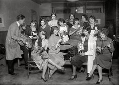 "Greenwich Village Follies girls mending toys."" December, 1924"