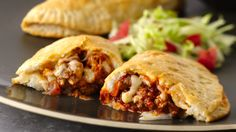 A tender, flaky biscuit wraps around your favorite taco fillings in an easy, flavor-packed hot sandwich.