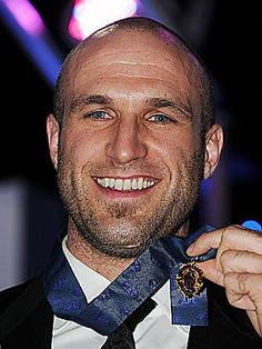 CHRIS JUDD ~ (born 8 September is a professional Australian rules footballer and former captain of the Carlton Football Club in the Australian Football League (AFL). Judd has twice won the league's highest individual honour, the Brownlow Medal. Carlton Afl, Carlton Football Club, Australian Football League, West Coast Eagles, Funny Vintage Ads, 8 September, Top Man, Australian Men, Bald Men