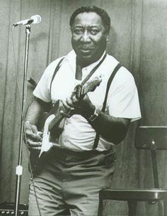 Muddy Waters | Although he was born in Mississippi, Muddy Waters is considered the Father of Chicago Blues.  By electrifying the delta blues of his youth, Waters almost singlehandedly influenced the British blues explosion of the '60s.