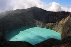 "Kelimutu crater lakes in Flores Island, Indonesia ""The westernmost lake is called the Lake of Old People and is usually blue, and the other two are called the Lake of Young Men and Maidens and Bewitched or Enchanted Lake, which are typically green and red, respectively. The colors vary on a periodic basis and have become a popular tourist destination."""