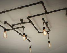 Lustre en tuyaux de fonte pour 6 ampoules