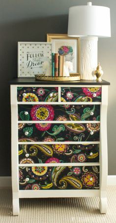 Hometalk :: Dresser Makeover Using Fabric And Mod Podge.  Consider using this to dress up our ugly white shelves upstairs.  Maybe us on sides or backs of shelves?