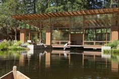 Visitors must traverse a bridge to enter this family dwelling by US studio Cutler Anderson Architects, which was built atop a pond outside the town of Newberg. Find out more about Newberg Residence Wooden Cabins, Wooden House, Glass Cabin, Architecture Résidentielle, Natural Pond, American Houses, Steel House, Home And Family, Modern Family
