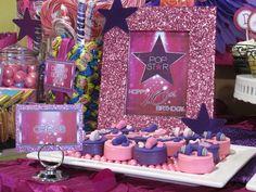 Pop star themed table sign.