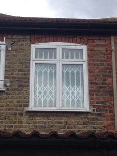 RSG1000 Folding Security Grills fitted internally to the window of a residential property in Central London