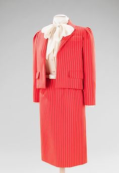 This is an ensemble by Bill Blass. It was worn by Nancy Reagan to two White House events in 1981. Reagan was known for her signature red color.