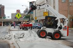 Bobcat's S250 skid steer outfitted with a jackhammer attachment. This loader has an operating capacity of 2,500 pounds.    Full specs:  http://www.specguideonline.com/product/bobcat-s250    #bobcat #skidsteer #loader #construction #equipment