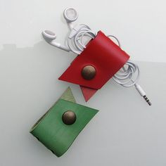 Leather earbud / earphone / cable organizers in red and green vegetable tanned leather, handmade by RinartsAtelier