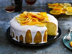 Citrus lovers, this one's for you. A buttery citrus cake with glace icing and candied orange and lemon slices.