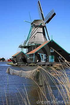 Famous picturesque Zaanse Schans in Netherlands. Group of historic old windmills .