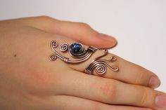 Wire Wrapped Ring-copper ring-adjustable wire wrapped copper ring with navy blue crystal stone-wire wrapped jewelry handmade-copper jewelry. $20.00, via Etsy.
