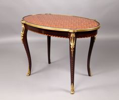 Late 19th Century Louis XV Style Gilt Bronze Mounted Parquetry Top Center Table