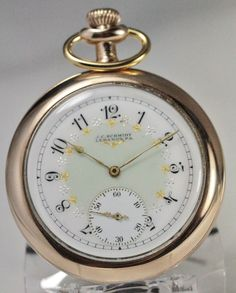 Delightfully Detailed Vintage 1911 Elgin Pocket Watch From the whimsical scrolled numerals, luscious lime dial, and fine Fahy's Montauk 14K gold filed case, this magnificent 12 size pocket watch could become a favorite.