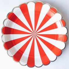 Stripe plates by Meri Meri These red stripe party plates are 180mm x 180mm and come in a set of 8, they feature a scalloped edge that is trimmed with silver foil. We love them as they just shout Circus big top .... and co-ordinate perfectly with other party items in our CIRCUS range.