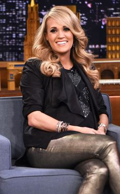 Talk Show Style from Carrie Underwood's Pregnancy Style  The expectant country songstress visits The Tonight Show Starring Jimmy Fallon on Dec. 8 in an adorable black blazer and metallic pants get-up.