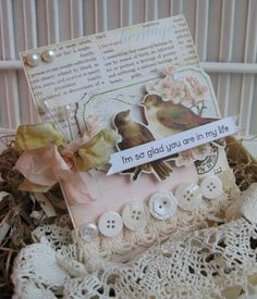 Vintage style bird-themed card, created with shabby papers, laces, buttons, seam binding, pearl stick pins, and pearl buttons
