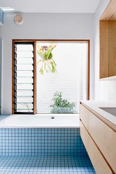 baby blue square tiles and light wood in this modern bath renovation | via coco kelley