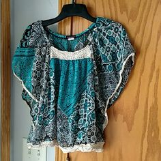 Beautiful blouse This looks great with black or white bottoms, same with shoes. Wear it with a few other pieces and have several looks. Comfortable and light. Cocomo Tops Blouses