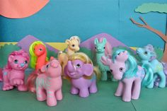 """I didn't even know these existed!  These """"Pony Friends"""" came out in two consecutive years between 1986 and 1988.   From 1986: Kingsley the pink lion, Spunky the blue camel, Zig Zag the pink zebra, and Creamsicle the yellow giraffe.  From 1987: Oakly the purple/pink moose, Edgar the purple elephant, Cutesaurus the neon orange dinosaur, and Cha Cha the sea green llama."""