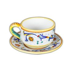 Ricco Latte Cup & Saucer - This robust Italian ceramic latte cup with saucer is a great way to bring a taste of Italy into your own home, while tasting your favorite warm beverage (or even soup, cereal or ice cream!). The classic fleur-de-lis design will surely enrich your coffee or tea drinking experience! Found at the Italian Pottery Outlet in Santa Barbara, CA