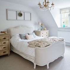 CHI Nov 17 p 60 Elegant white bedroom with French bed. Again overall feel is very calming which i like! but not sure how i feel about the bedside tables being ?distressed wood/ ?will it always feel a bit messy . i like how the table lamps are small, don't take up as much space