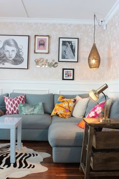 Scandinavian Chic: Living Room Update, gray sectional, bright pillows, wallpaper