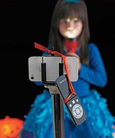 """DIY Photo Booth Idea: Position a tripod made to hold a smartphone about five feet from the backdrop, and have a remote control handy for self-portraits. For instant gratification, add a small photo printer to your """"studio."""""""