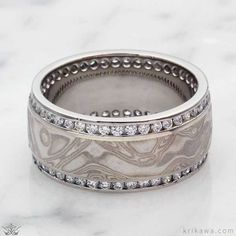 A wedding ring with substance and style! The Mokume Double Diamond Channel Wedding Band features the mokume of your choice framed by two channels of the stones of your choice! Design yours today!