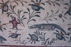 Gladiator And Crocodile Mosaic    -- An ancient Roman mosaic showing a gladiator about to take on a huge crocodile. The mosaic is in the gardens of the ancient Roman Villa Sileen on the north coast of Libya near Leptis Magna