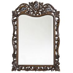 Wall mirror with a floral openwork frame.      Product: Wall mirror    Construction Material: Resin and mirrored glass...