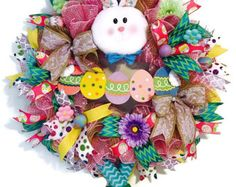 EASTER BUNNY Front Door WREATH, Spring Mesh Wreath , Whimsical Rabbit Wreath, Bunny Wreath with Ears and Bunny Butt, Easter Decoration, Ready To Ship  This Colorful and Bright Pastel Peeps Easter Bunny Wreath featuring Bunny Ears and Bunny butt will compliment your Easter decor beautifully.   Product Details: 24 Wire Wreath Form 10Pink & White Snowball Mesh 10 Laser Metallic Pink Deco Mesh Matching Ribbon Floral include Mini Tulips, and Peonies Decorative Butterflies and Easter Eggs Peeps...