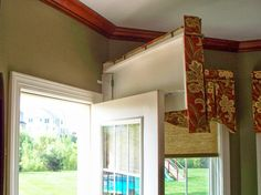 From The Workroom of Parkway Window Works. Finally, a solution to matching that door's window treatment to the nearby windows'!