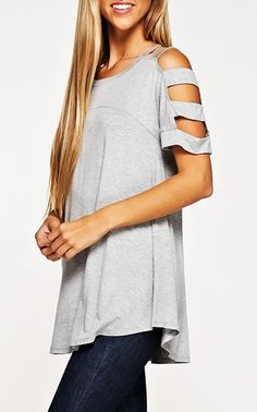 Heads will turn when you wear the grey Naomi tunic! Unique ladder cut open shoulders, super soft knit, and flattering loose fit make this a must-have for every closet! Fits true to size. Free Shipping