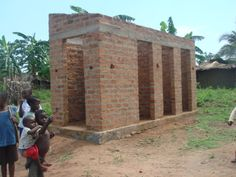 Latrines being built with the brick school. Girls rarely stay in school beyond puberty if there are no latrines.