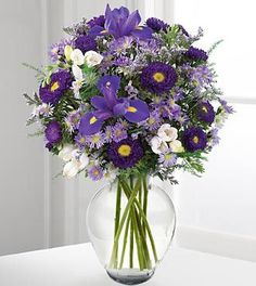 Create a romantic aura -- this lavender and purple bouquet is the perfect gift for a new loved one, or the one and only one you've loved for years. Purple iris are surrounded by lavender freesia, purp